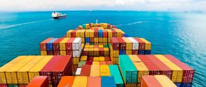 Shipping Containers on Ship that is on the Water