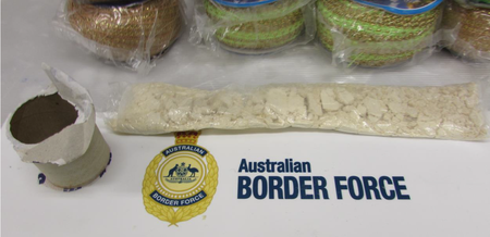 1kg of Heroin, cash, and firearms seized in joint investigation, Gold Coast